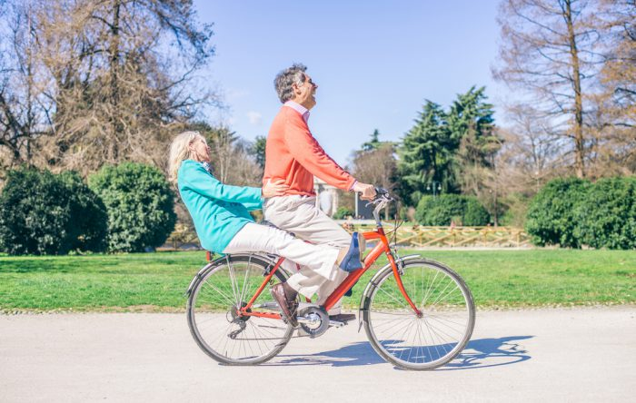 Middle aged couple on a bike