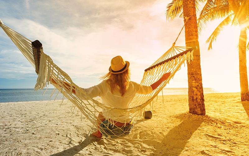 Women in hammock on a beach